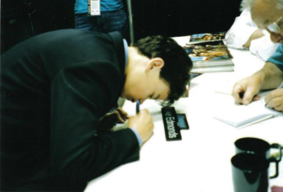Me signing one of my first autographs at Celebration II (I was not signing at that one, but did do few autographs here and there). This one was for Mike Edmonds. In fact, he still owes me one in return!