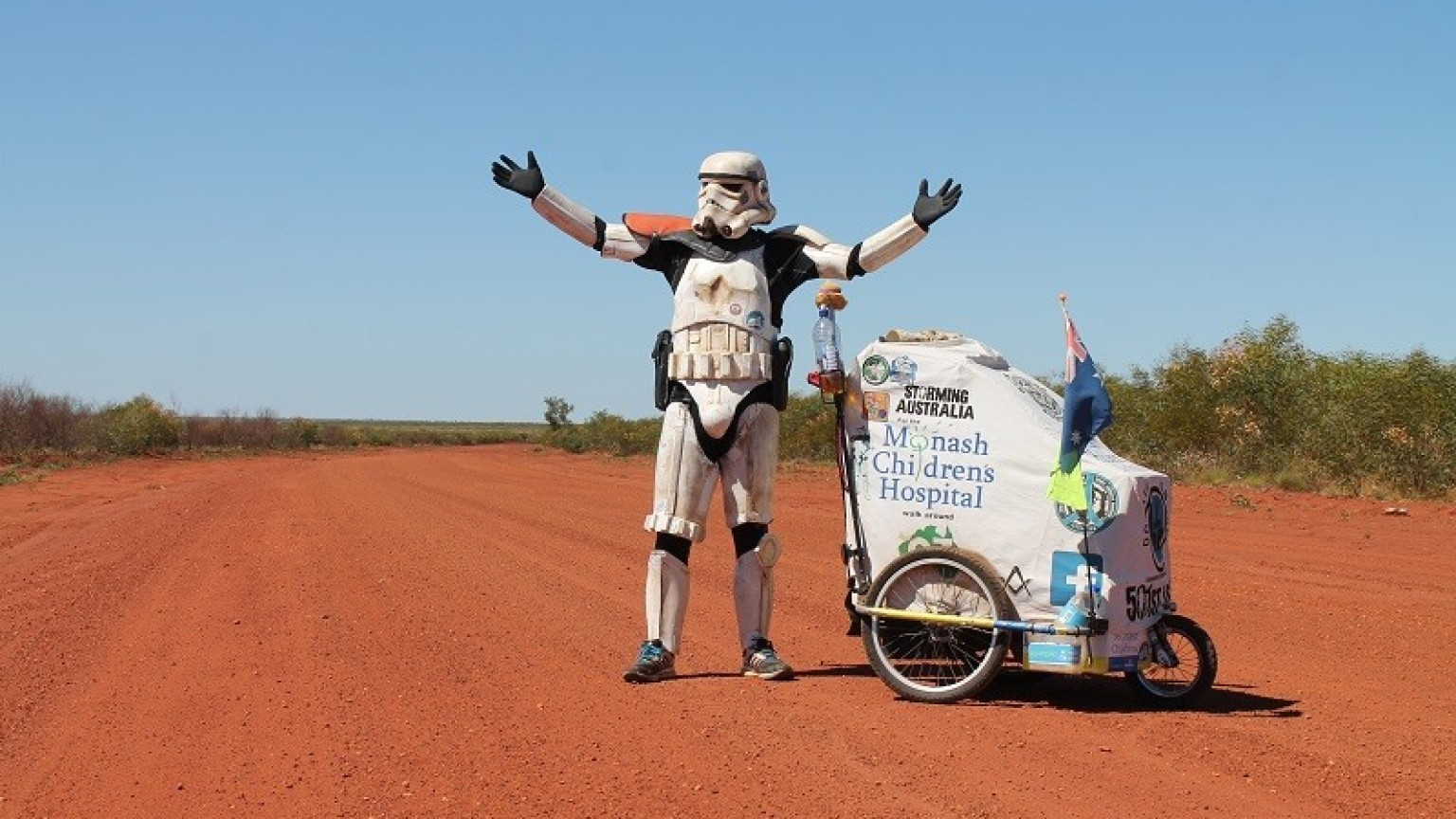 Scott Loxley in stormtrooper armor walking down a path.