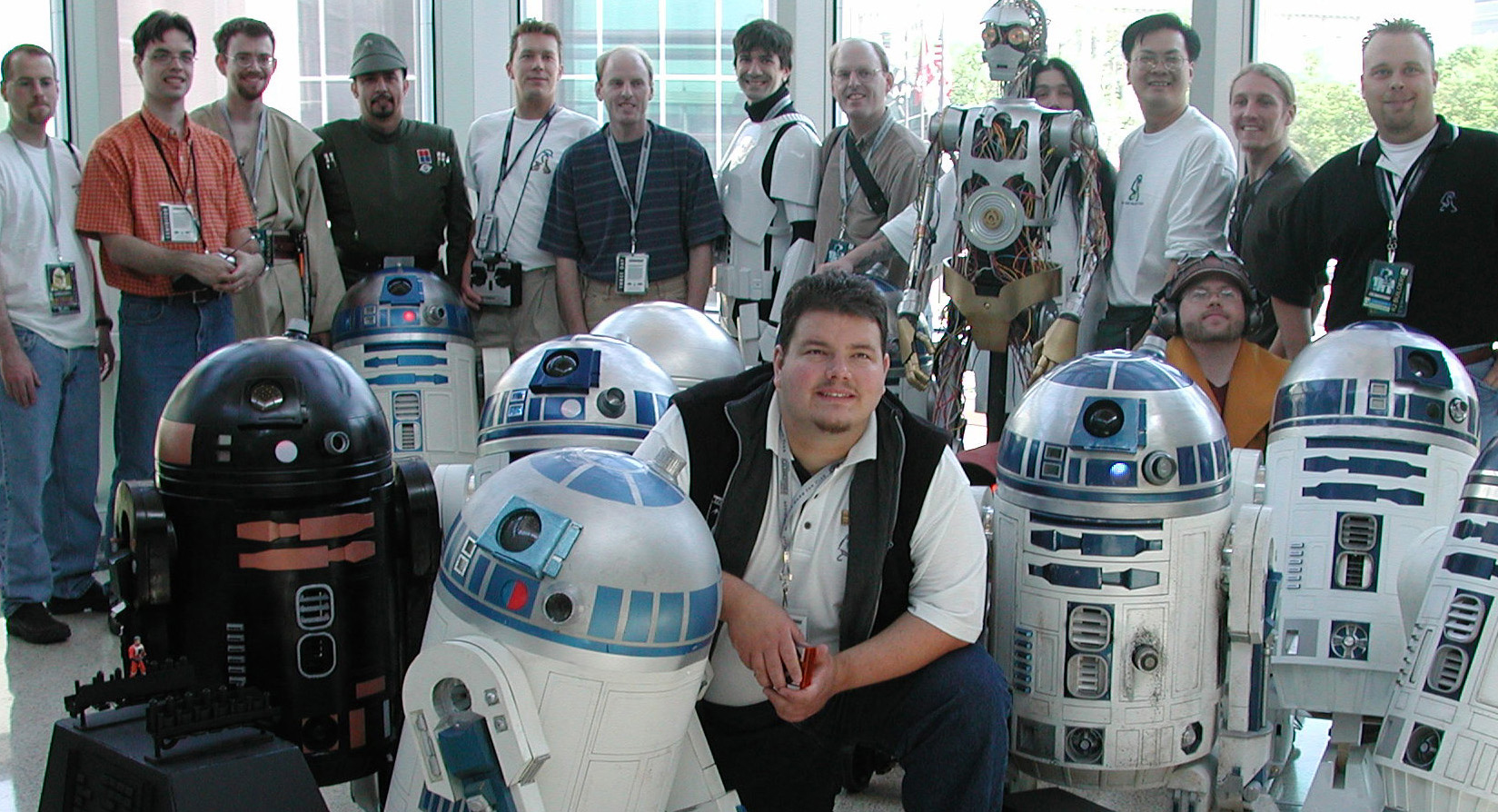 The R2-D2 Builders' Group, at the forefront of fan involvement in the Celebrations, requested space for a special display room. They outdid themselves with educational exhibits and panels on how to build accurate droids on a budget. They set the standard for fan-designed exhibiting at the show. A highlight was the R2-D2 Parade, with an array of remote-controlled droids grand marshaled by Kenny Baker (R2-D2 in the Star Wars movies). Photo courtesy of Celebration II archives.