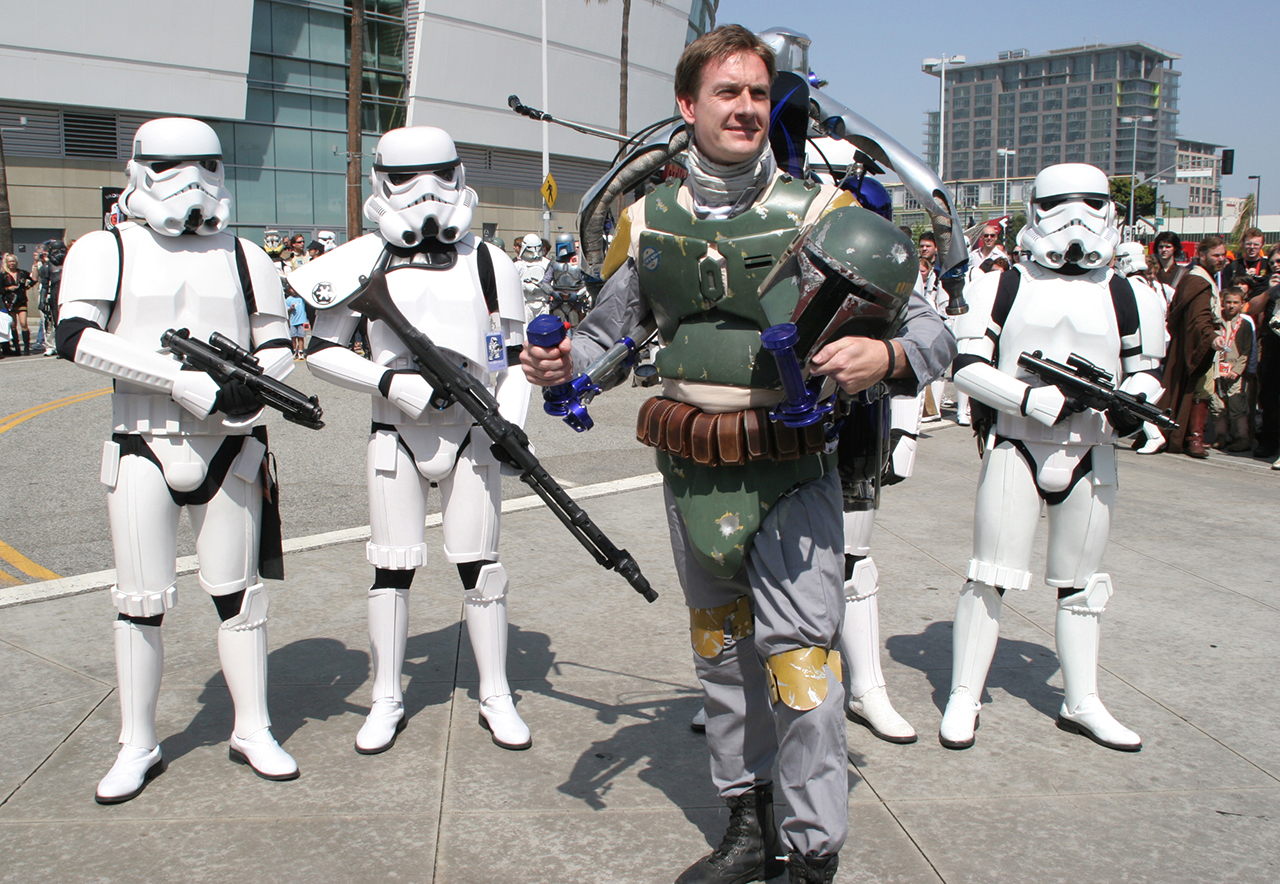 Flying Fett. Shortly after touching down outside the Los Angeles Convention Center, Boba Fett with a real jetpack is greeted by waiting stormtroopers. Photo by Karen Louie.