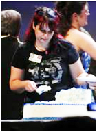 """I could not find many decent photographs of the Epic Cake Serving -  the event might have been too traumatic for my Elite Squad. Volunteer Kim Knight helps """"Team Cake"""" serve more than 5000 pieces of cake to fans during the Opening Ceremonies at Celebration IV. The cake, inspired by the 30th anniversary of the Star Wars Saga, was distributed by a dedicated team of Celebration volunteers - my invaluable Elite Squad - who not only love Star Wars but also help behind the scenes to make the events a success. Many have traveled to the Celebrations worldwide, and I will see many of them again at Celebration Europe. I thank the Maker for them every event. Photo by C. Scott Campbell."""