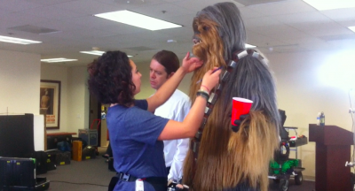 Frank the Wookiee gets his hair done.