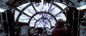 The Millennium Falcon cockpit interior while jumping to lightspeed