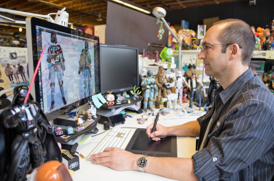 Brian Ewing,senior designer for Disney Store, at work on Star Wars toys