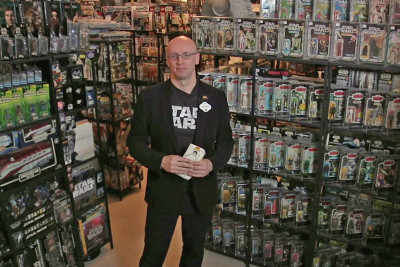 Jonathan Storey and his amazing Star Wars collection, holding his first item, a Princess Leia pencil case