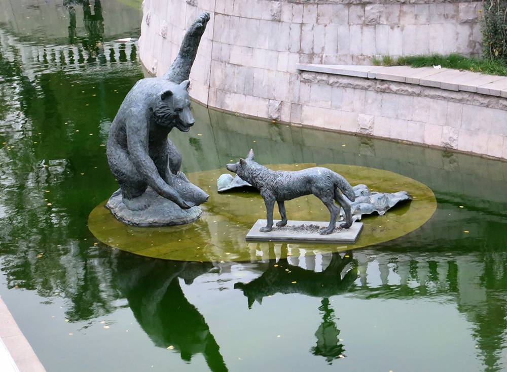 I'm thinking the coyote needs to give up on the salmon idea…quickly. From a fountain near the Kremlin walls.