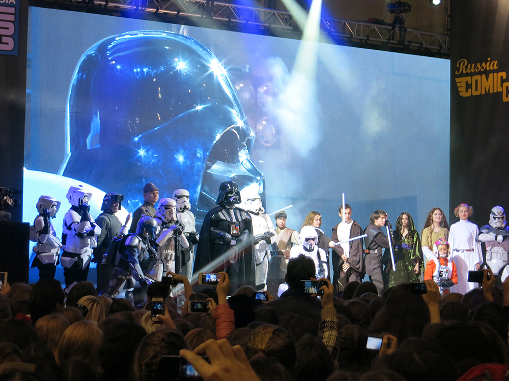 Sunday afternoon the Comic Con Russia management invited the Star Wars costumed fan groups to present their costumes on the main stage. The cheering crowd loved it all, and gave thunderous applause as Vader strode to the center. Both the 501st and Rebel Legion had a recruiting video that was played behind them on the big screen, showing their charity work, samples of their great costumes, and how to join.