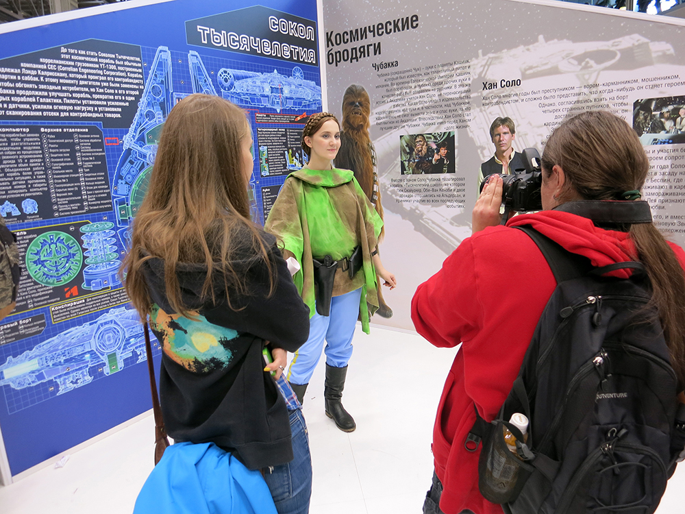 Princess Leia costumer draws a crowd for photographs by our Millennium Falcon background.