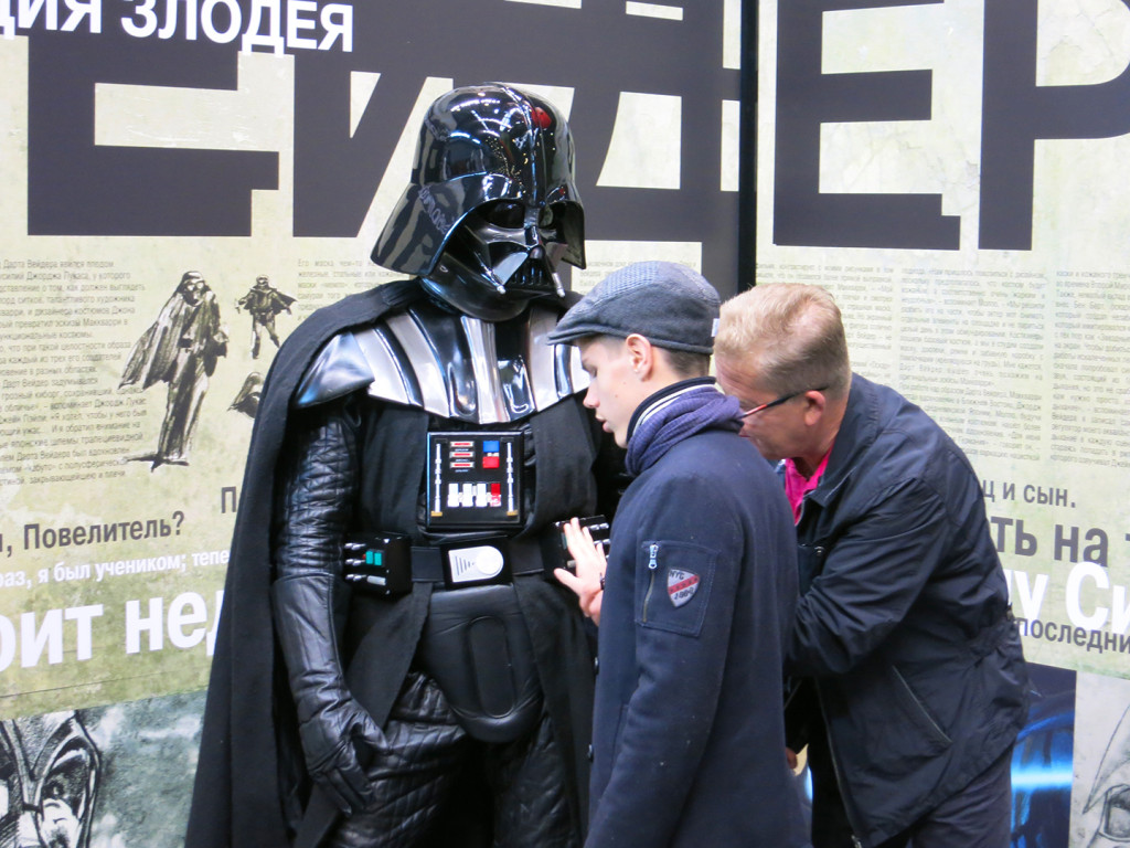 """One afternoon, a father brought in his blind son to """"see"""" Darth Vader with his fingertips. The young man carefully moved his hands across the helmet, chest and shoulder pieces and the lightsaber as his father connected what he was touching to what he knew about Darth Vader from the Star Wars story. The bustling crowd waiting for photographs grew respectfully hushed while this happened. As the father and son walked away, the onlookers burst into applause."""