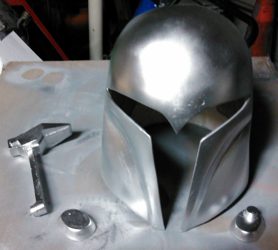 Sabine helmet, primed and coated with metallic aluminum paint in preparation for final painting.