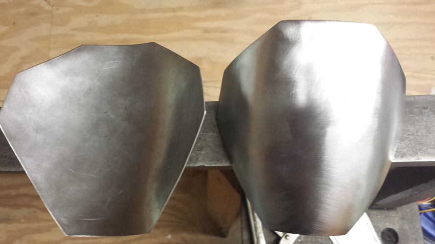 Completed steel shoulder bells, all nice and shiny.  Eat your heart out Jango Fett!