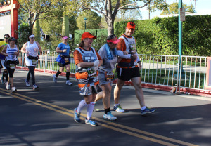 Rebel Pilots lend a hand to a fellow runner in need