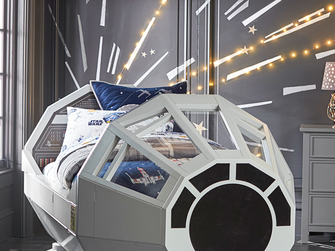 Millennium Falcon bed with hyperspace mural