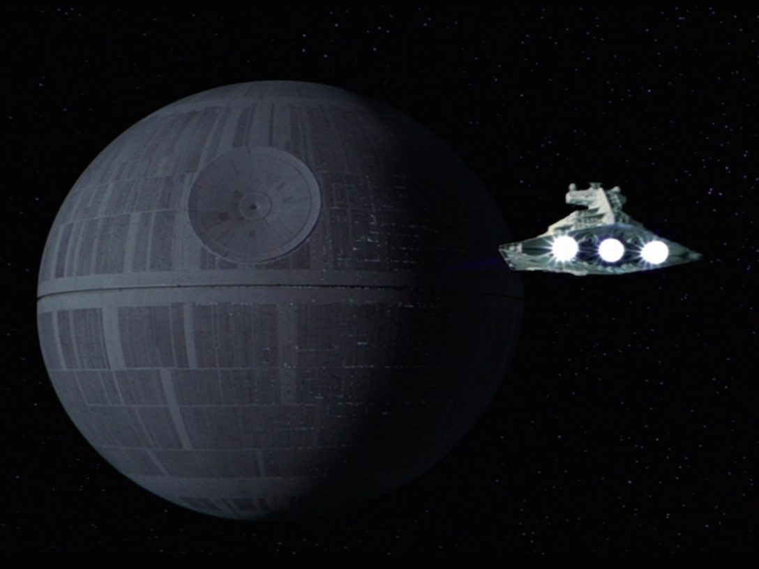 An Imperial Star Destroyer approaching the Death Star