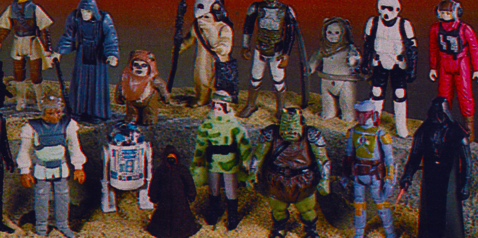 Miniature figurines of various Star Wars characters including Darth Vader, Boba Fett, and R2-D2