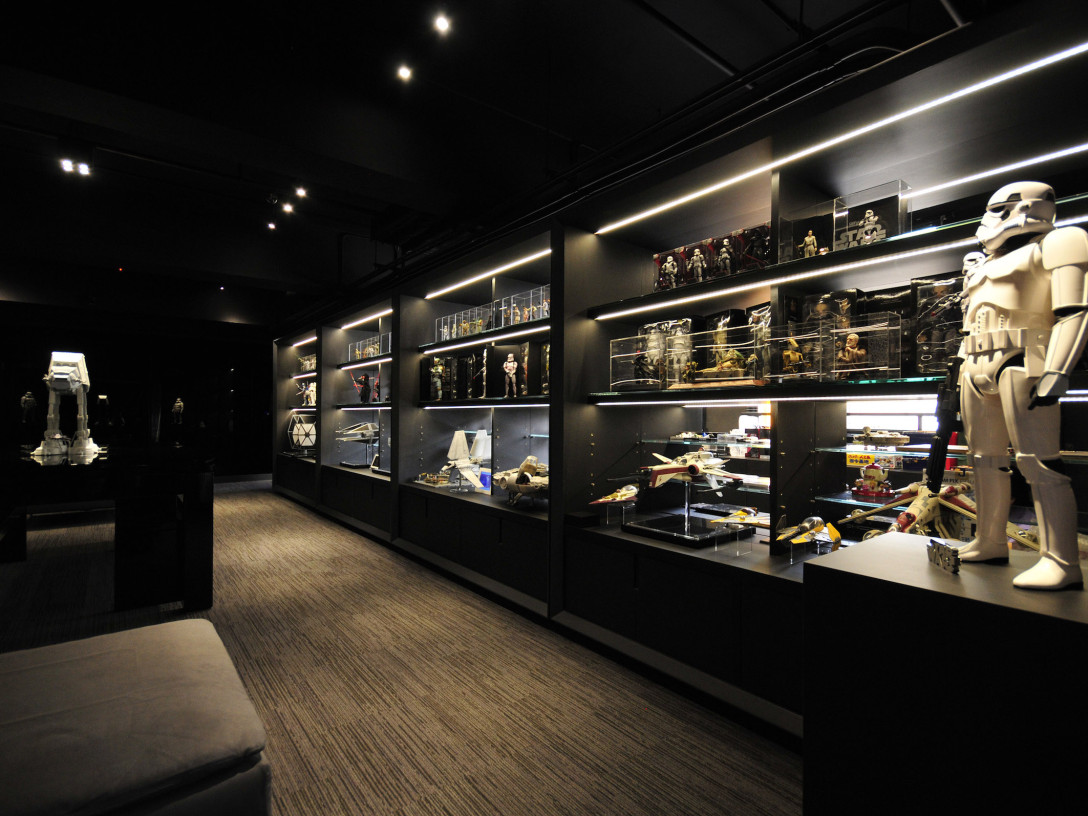 A display wall featuring items from Barrie Ho's collection