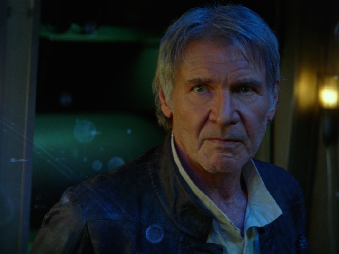 Han Solo standing amidst a star map being projected within the Millennium Falcon