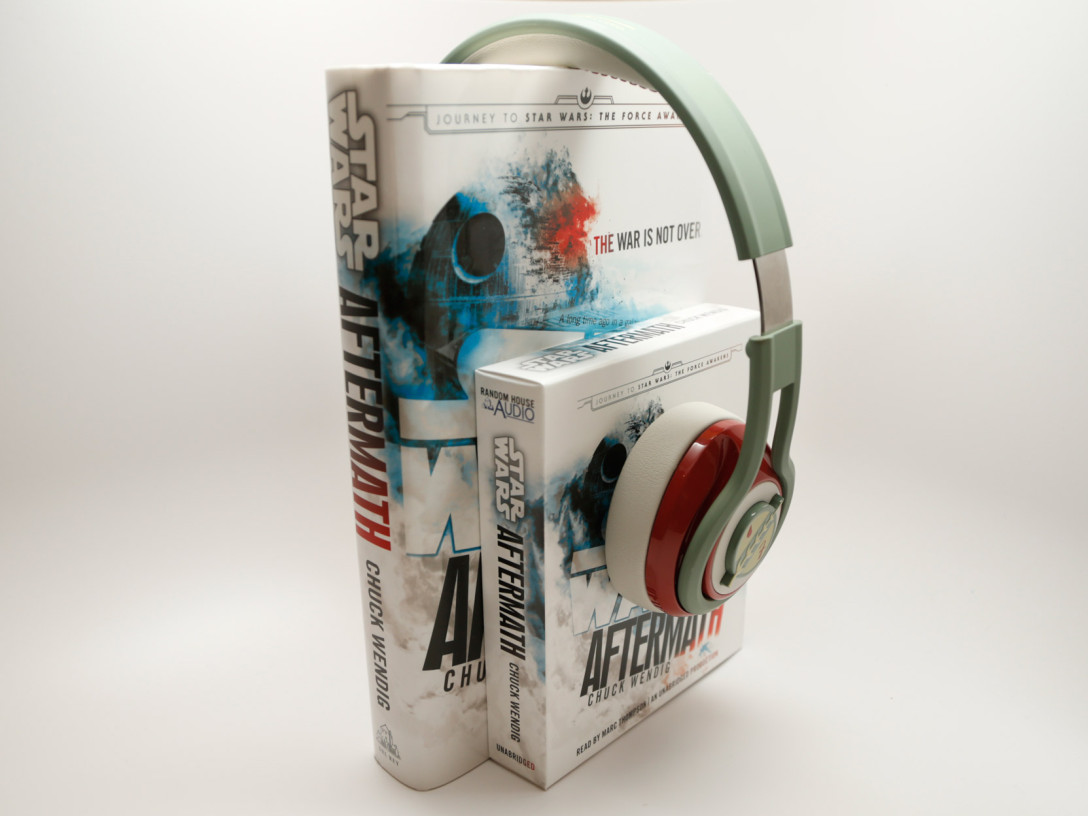 "A pair of headphones resting atop both the print and audio books of ""Star Wars: Aftermath"""