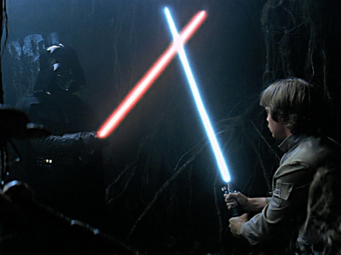 Luke Skywalker dueling a Darth Vader apparition in the Cave of Evil