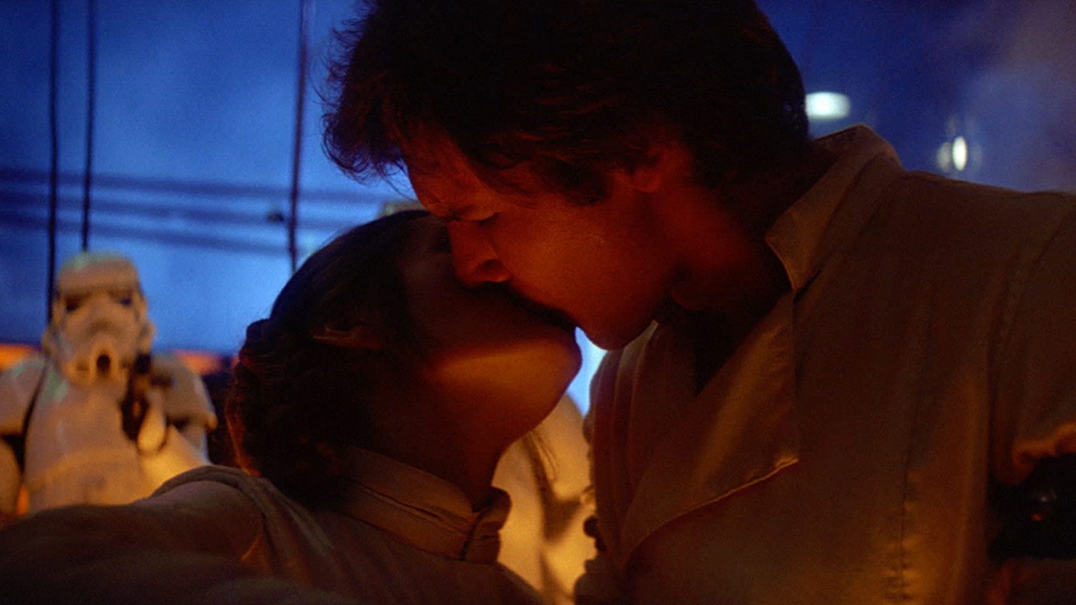 Han and Leia kiss before Solo is frozen in carbonite in Star Wars: The Empire Strikes Back.