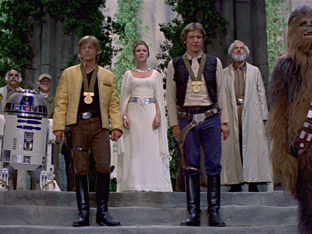 C-3PO, R2-D2, Luke, Leia, Han and Chewie at the medal ceremony.