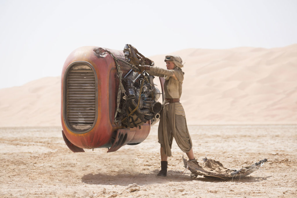 Rey with her speeder in Star Wars: The Force Awakens.