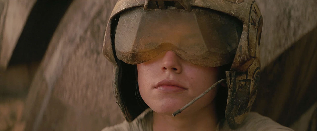 Rey with X-wing helmet