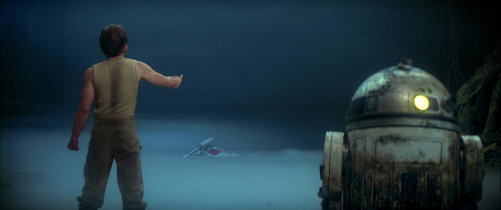 Luke Skywalker tries to raise his X-wing from the Dagobah swamp.