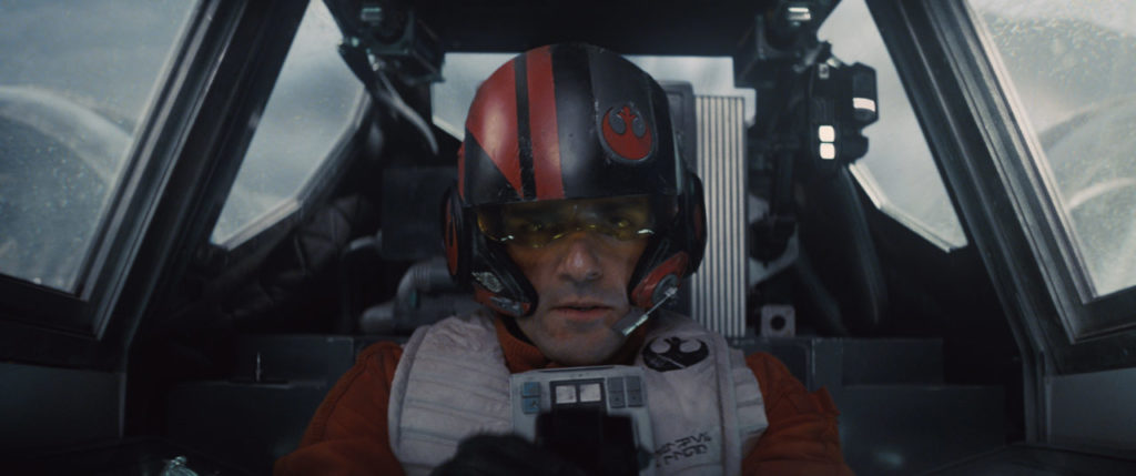 Poe Dameron in his X-wing cockpit in Star Wars: The Force Awakens.