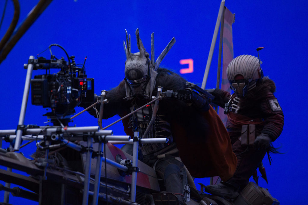Behind-the-scenes shot of Enfys Nest on her swoop bike in Solo: A Star Wars Story.
