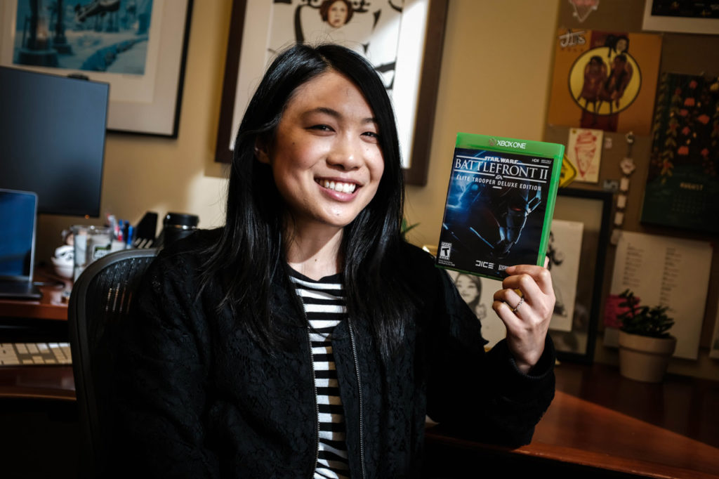 A member of the Lucasfilm Games Team holds up the box of Star Wars Battlefront II.
