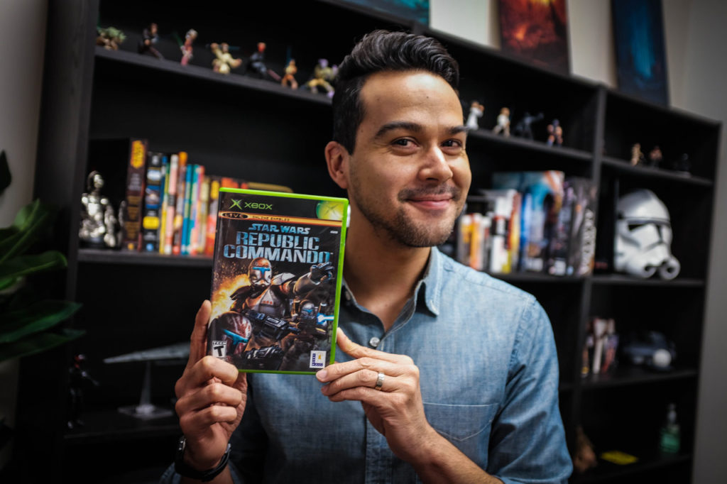 A member of the Lucasfilm Games Team holds up the box of Star Wars: Republic Commando.