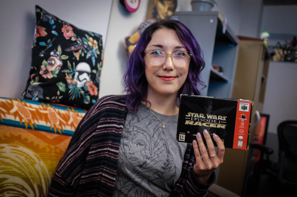 A member of the Lucasfilm Games Team holds up the box of Star Wars Episode I: Racer.