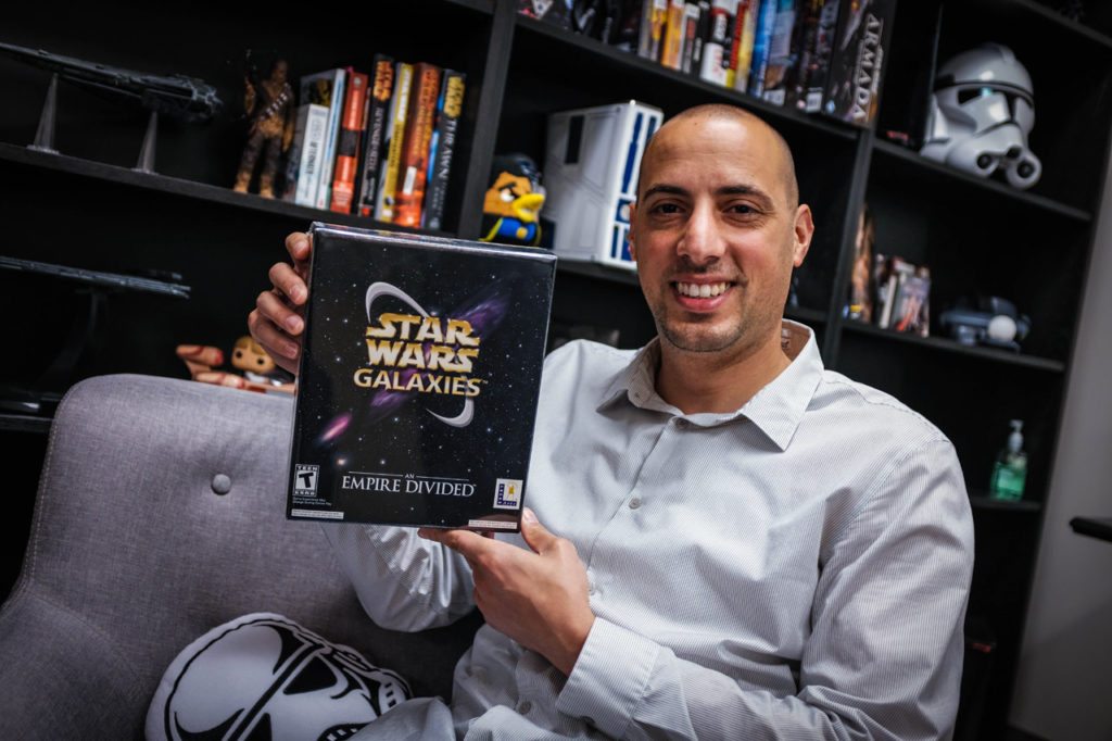 A member of the Lucasfilm Games Team holds up the box of Star Wars Galaxies.