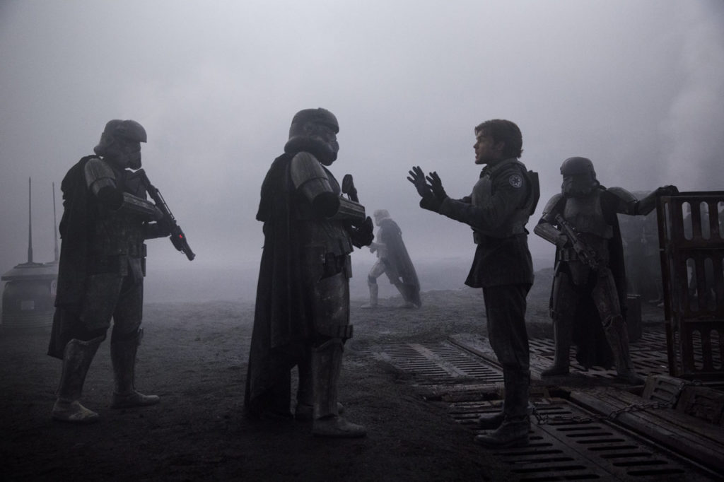 Han Solo tries to talk his way out of trouble to two stormtroopers on Mimban in Solo: A Star Wars Story.