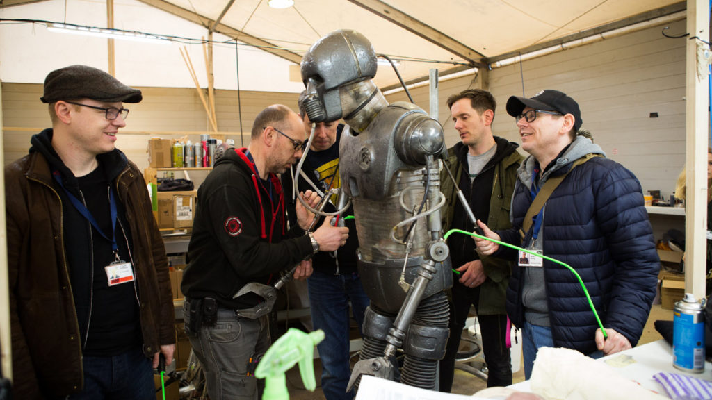 Brian Herring and members of the creature shop work on a medical droid for Solo: A Star Wars Story.
