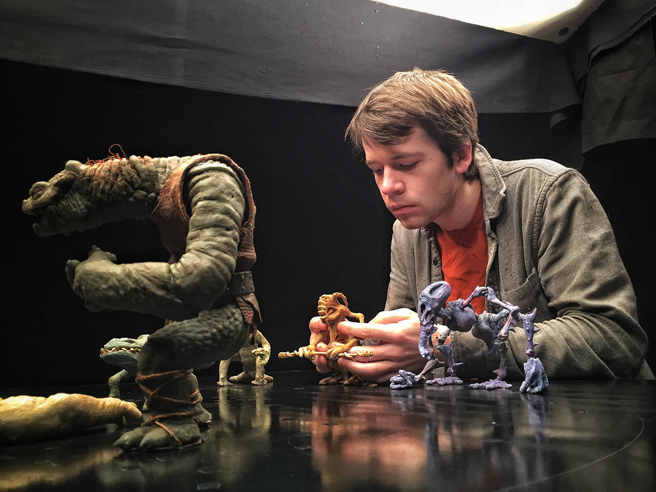 David Lauer, of Tippett Studio, works on the holochess set.