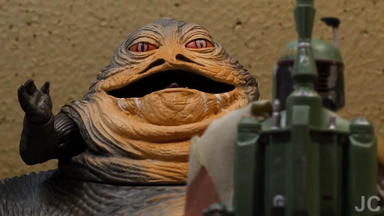 "Jabba the Hutt speaks with Boba Fett in a scene from ""Bounty Buddies."""