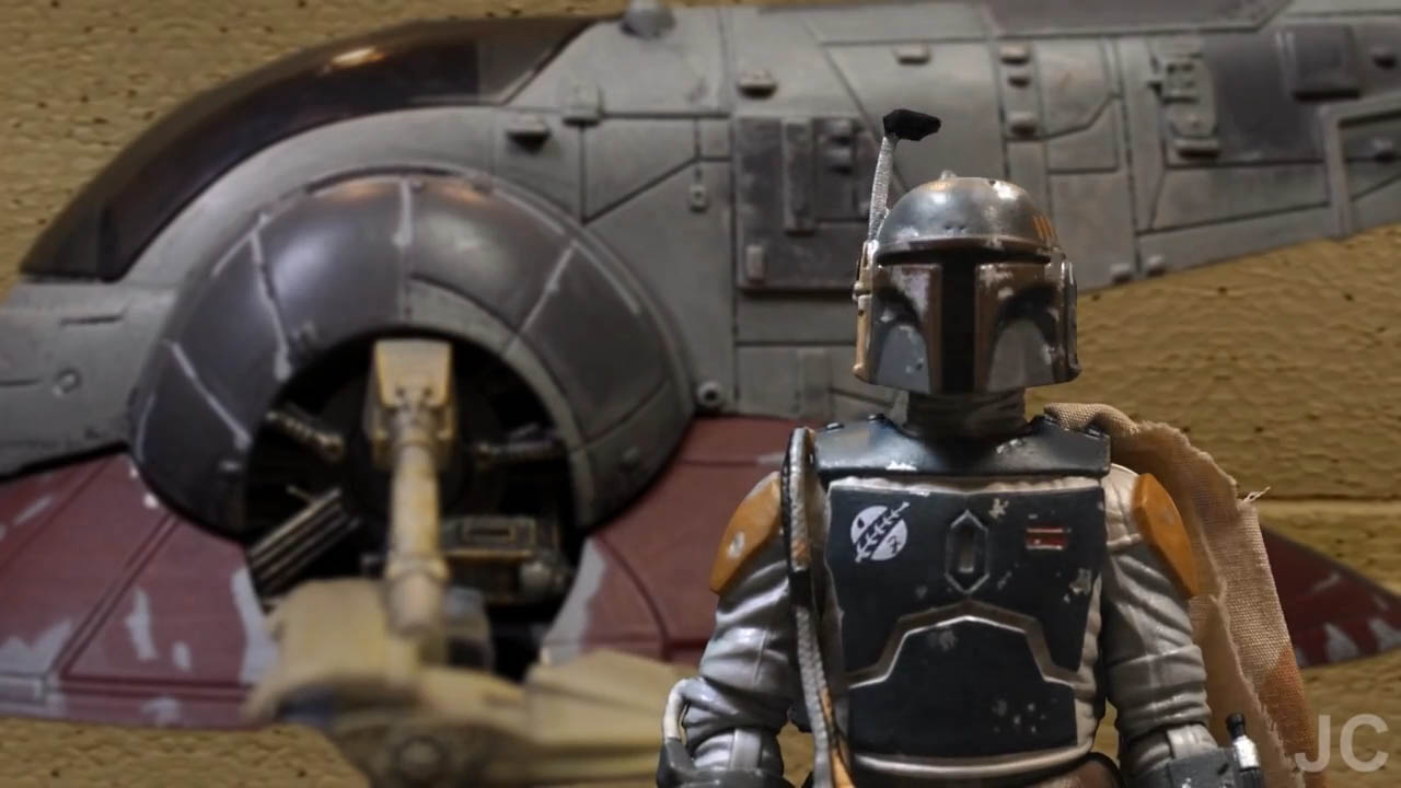 "Boba Fett stands before Slave I in a scene from ""Bounty Buddies."""