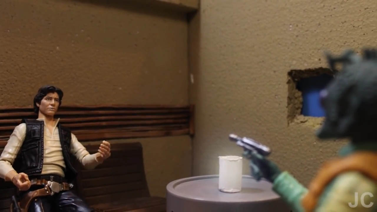 "Greedo confronts Han Solo in a scene from ""Bounty Buddies."""