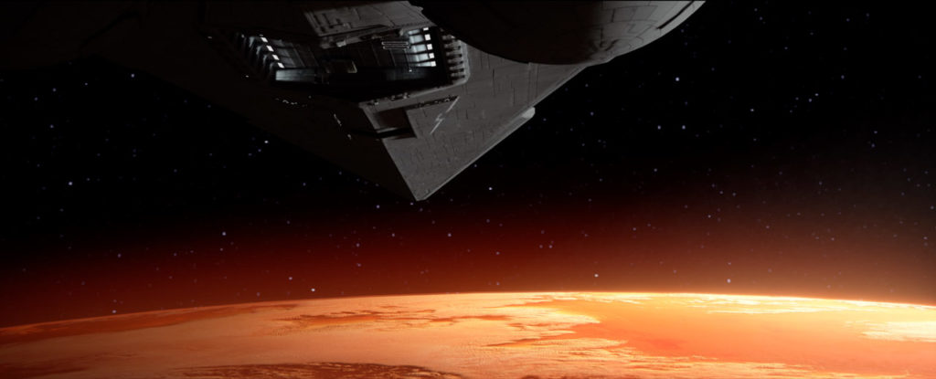 A Star Destroyer approaches Mustafar in this still from Vader Immortal: A Star Wars VR Series -- Episode I.
