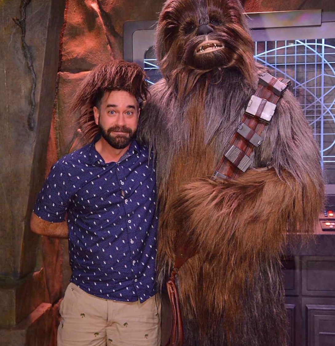 Aaron Sagers standing with Chewbacca