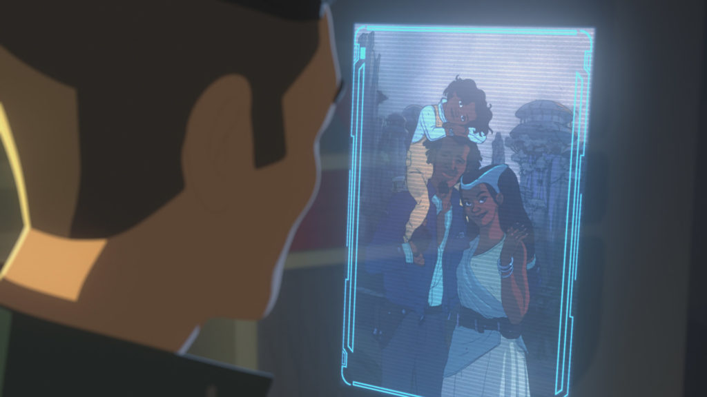 Kaz looks at a holo of Yeager's family on Batuu.