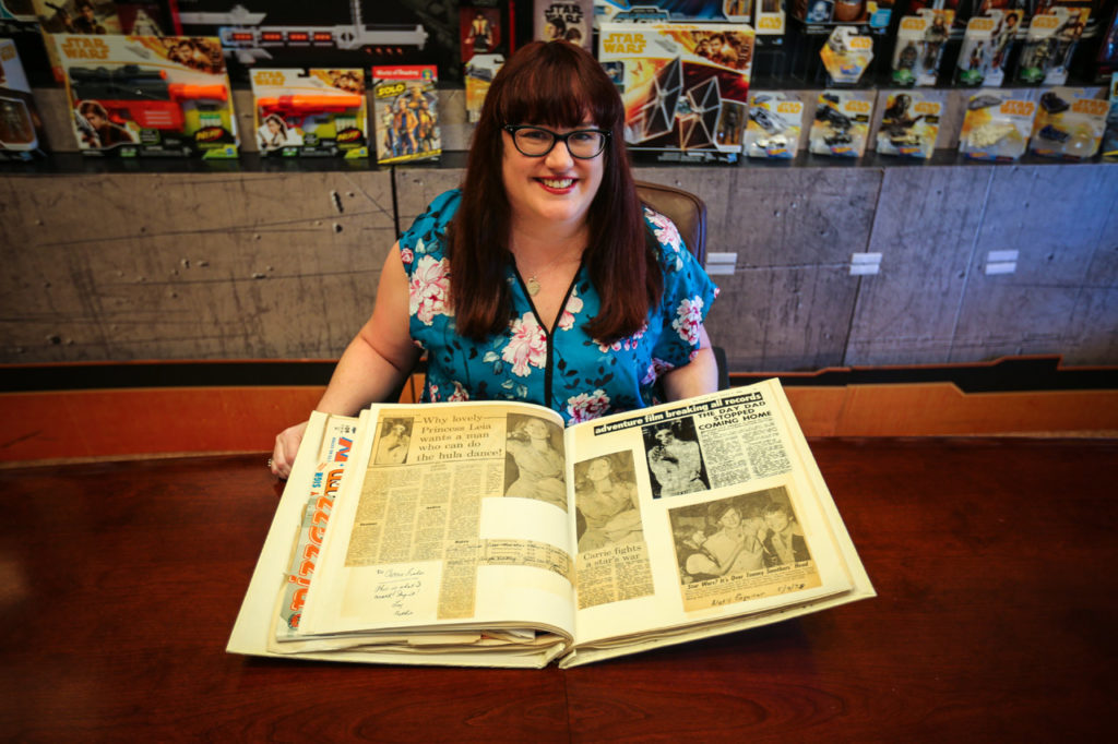 Lucasfilm's Jennifer Heddle with her scrapbook owned by Carrie Fisher.