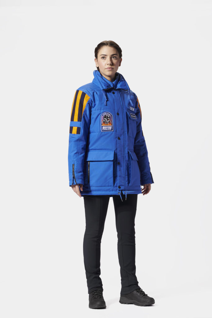 A female model sporting the Star Wars: Empire Crew Parka.