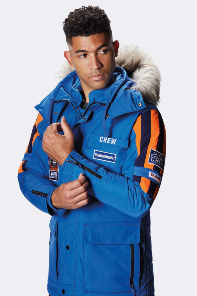 Male model wearing Columbia's Star Wars: Empire Crew Parka.