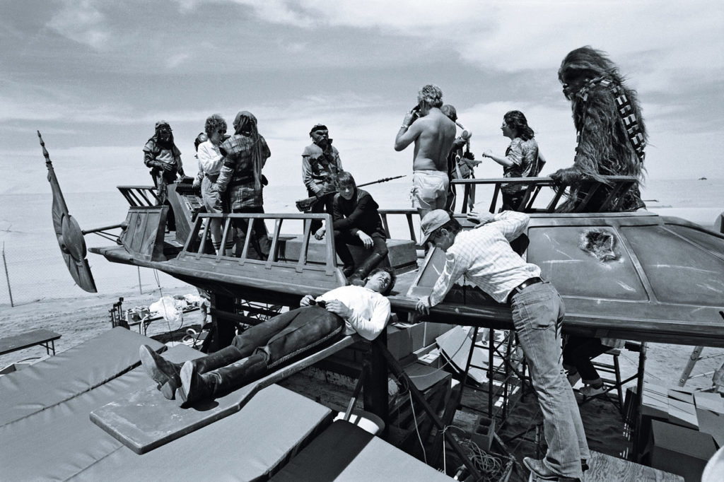 Harrison Ford rests on the plank of Jabba's sail barge, photo from the book Star Wars Icons: Han Solo.