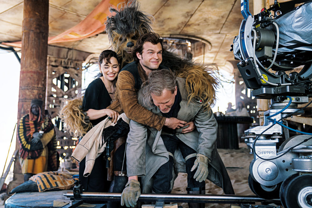 The cast laughs behind the scenes of Solo: A Star Wars Story, from the book Star Wars Icons: Han Solo.