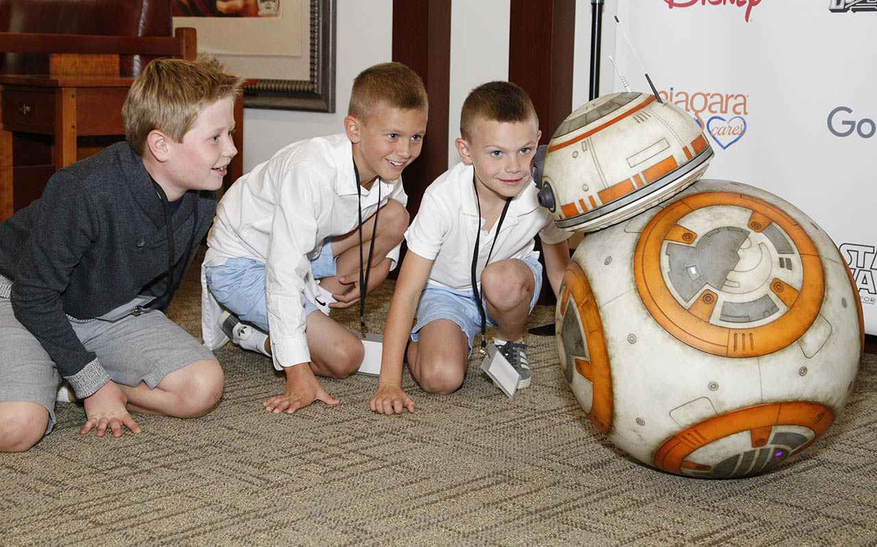Children meet BB-8 at the Starlight Children's Foundation event to launch 'Starlight Xperience.'