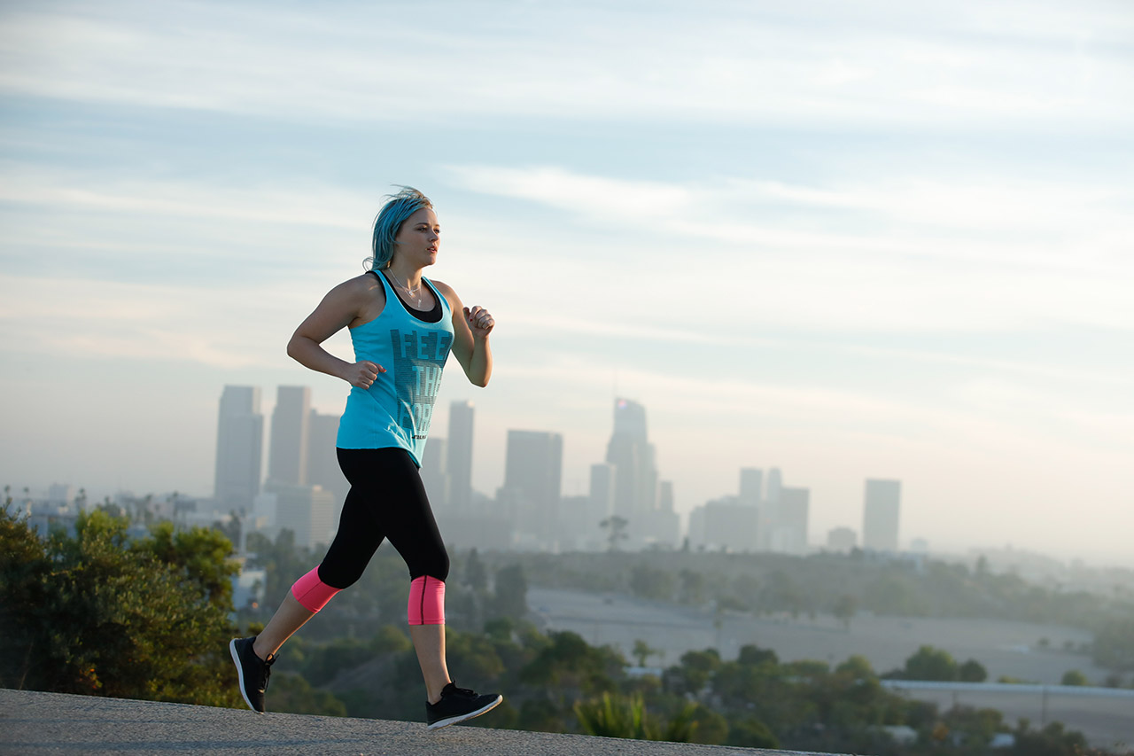 A runner jogs in front of a city skyline as part of Fuel Your Force.
